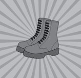 Boots. On dynamic gray background, vector illustration Royalty Free Stock Photography