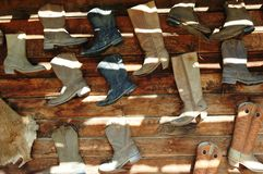 Boots. Hanging on wall Royalty Free Stock Photos