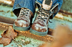 Boots and autumn leaves Royalty Free Stock Photos