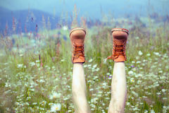 Boots. On a background of a blossoming meadow Royalty Free Stock Photography