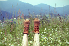 Boots. On a background of a blossoming meadow Royalty Free Stock Photo
