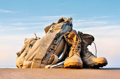 Boots and backpack Stock Images