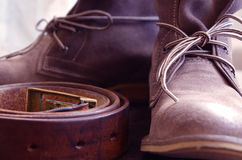 Boots and a Belt. Genuine Leather Boots and a Belt royalty free stock photography