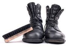 Boots and brush. Military boots and brush isolated on white background Stock Image