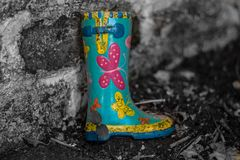 Boots and Butterflys in the Garden stock image