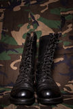 Boots and Camouflage Stock Images