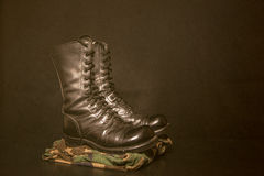 Boots and Camouflage Stock Image