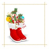 Boots with candies Stock Photos