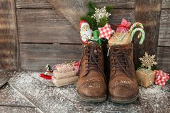 Boots with christmas presents. Leather boots with christmas treats and presents Stock Photography