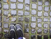 Boots on a Cobblestone Road in Belgrade royalty free stock image