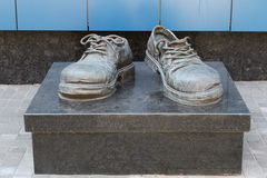 Boots of the commercial agent. A monument to the shoes of the commercial agent, which the worker worn out looking for clients. Ukraine, Kiev Stock Images