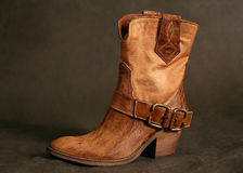 Boots of the cowboy. Female boots of the cowboy close-up on a dark background royalty free stock photos