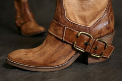 Boots of the cowboy. Female boots of the cowboy close-up on a dark background stock photo