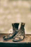 Boots and daisy Royalty Free Stock Photo