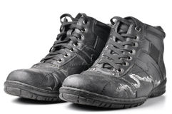 Boots damaged by reagents Stock Photos