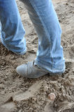 Boots in the dirt. Black paddock boots with blue jeans standing in the dirt Royalty Free Stock Photography