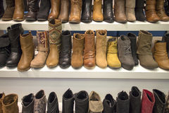 Boots display on white shelf Stock Image