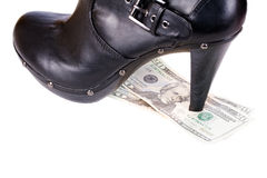 Boots and dollars Royalty Free Stock Image