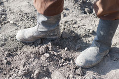 Boots on dry earth. Stock Photos