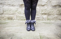 Boots female legs Royalty Free Stock Photography