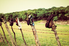Boots on a fence. Boots on posts of a fence in the texas hill country while on a drive down back roads Royalty Free Stock Images