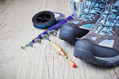 Boots and fishing gear Stock Photography