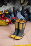 Boots On Floor At Fire Station Royalty Free Stock Photos