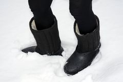 Boots with galoshes on the leg - valenki royalty free stock photography