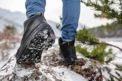 Boots going to the winter mountains. Close Up shot of the trekking shoes royalty free stock photo