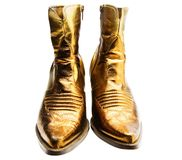 Boots of golden color Stock Images