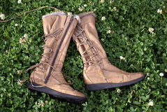 Boots grass Stock Photos