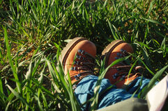 Boots in grass Royalty Free Stock Photography
