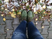 Boots. Green boots stand on autumn street Stock Photography