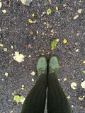 Boots. Green boots stand on land Royalty Free Stock Photo