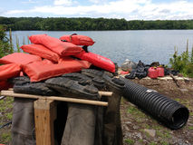 Boots Hanging Upside Down, Hip Wader Storage, Life Jackets, USA. Pop-up Clean-up at Woodcliff Lake Reservoir in Woodcliff Lake, New Jersey, on July 8th 2017: The Stock Images