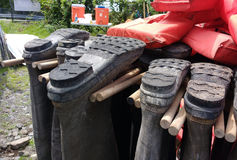 Boots Hanging Upside Down, Hip Wader Storage, Life Jackets, USA. Pop-up Clean-up at Woodcliff Lake Reservoir in Woodcliff Lake, New Jersey, on July 8th 2017 Royalty Free Stock Photography