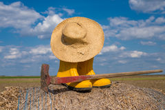 Boots, hat and hoe. Equipment for work in the field Royalty Free Stock Photography