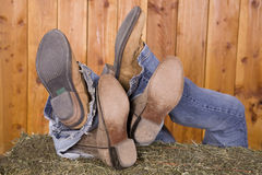 Boots on hay mixed Stock Photos
