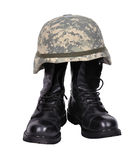 Boots and helmet. Military boots and helmet on white background Royalty Free Stock Photography