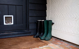 Boots by house door stock photos