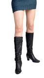 Boots with human legs. Black boots with human legs with white background Stock Image