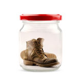 Boots in jar Royalty Free Stock Photos
