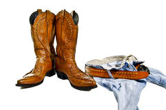 Boots jeans cowboy. Cowboy take off jeans and leather boots stock images