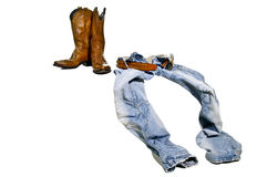 Boots jeans cowboy. Cowboy take off jeans and leather boots royalty free stock photos