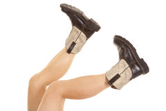 Boots legs. A woman's legs up in the air showing off her cowboy boots Stock Images