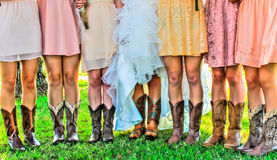 Boots and Legs of Girls in Wedding Party Royalty Free Stock Photography
