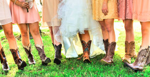 Boots and Legs of Girls in Wedding Party Stock Image