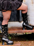 Boots and legs. Woman in boots with foot on a truck running board Royalty Free Stock Photography