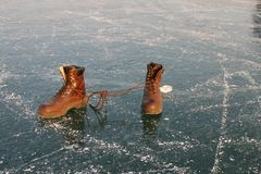 These boots are made for... A pair of brown leather boots on ice Royalty Free Stock Photos