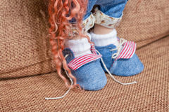 Boots made of thick denim stitched to a textile doll Royalty Free Stock Photos